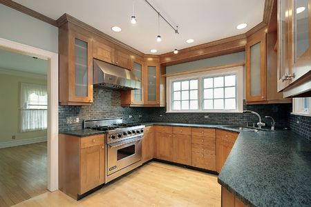 Kitchen in luxury home with granite counters
