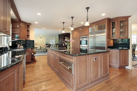 Kitchen in luxury home with granite counters photo