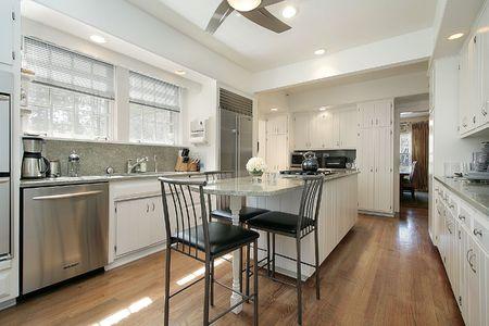 Kitchen in suburban home with granite island Stock Photo - 6738557