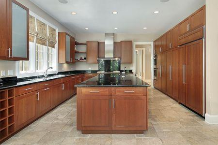 Kitchen in suburban home with granite island photo