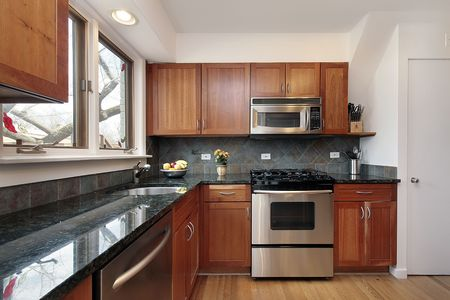 Kitchen in suburban home with cherry wood cabinetry Stock Photo - 6738734