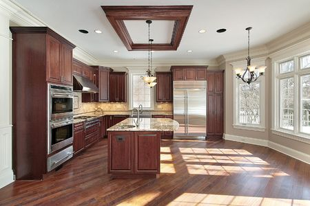appliance: Kitchen in new construction home with cherry wood cabinetry