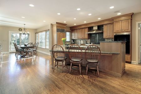 Kitchen and eating area with island in luxury home photo