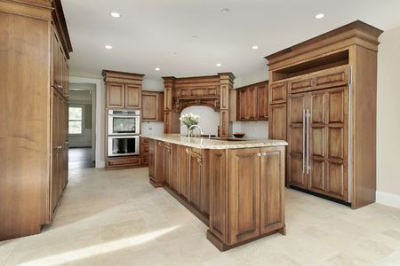Kitchen in new construction home with wood cabinetry Stock Photo - 6738831