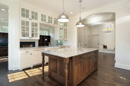 lighting fixtures: Kitchen in new construction home with white wood cabnietry Stock Photo