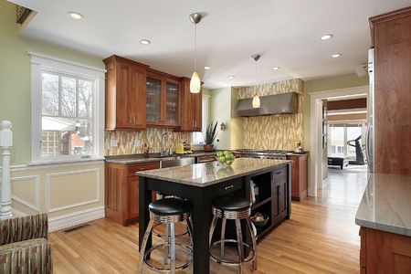 Kitchen in luxury home with granite island Stock Photo