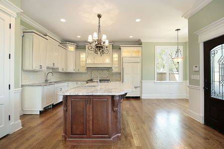 Kitchen in new construction home with granite island photo