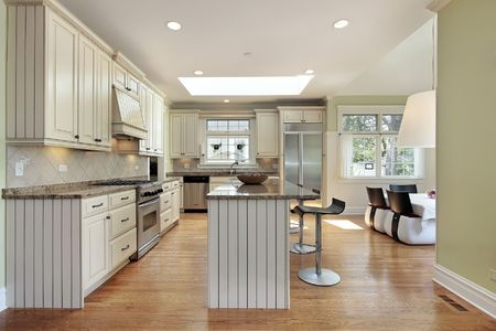 Kitchen in contemporary home with family room view Stock Photo