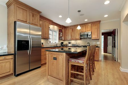 contemporary kitchen: Kitchen in luxury home with wood cabinetry