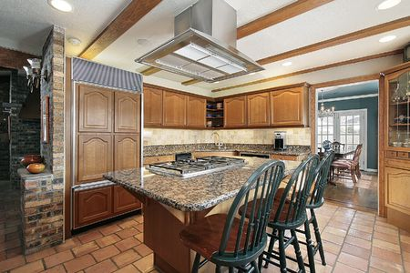 Kitchen in suburban home with orange tile photo
