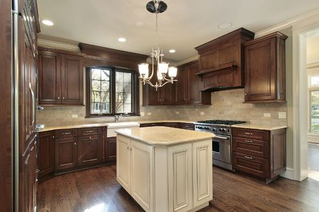 kitchen cabinets: Kitchen in new construction home with island
