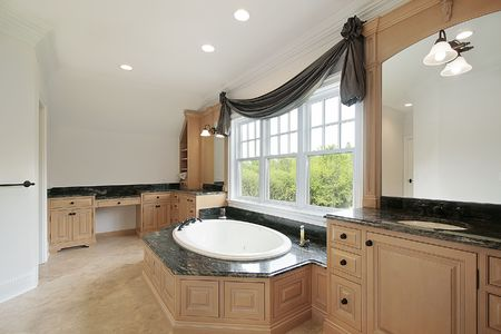 Master bath in new construction home wtih round marble tub photo