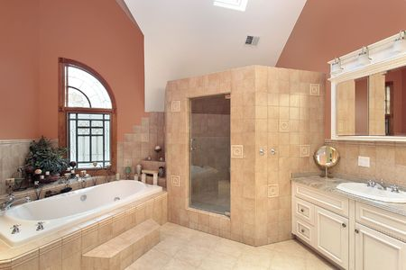 bathroom interior: Master bath in luxury home with orange walls