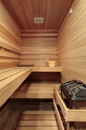 Sauna with wooden benches in suburban home photo