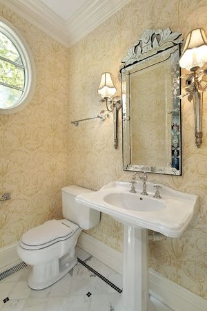 Powder room in new construction home with sconces photo