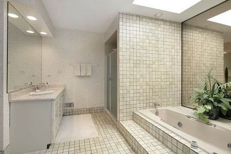 Master bath in suburban home with step up tile tub photo