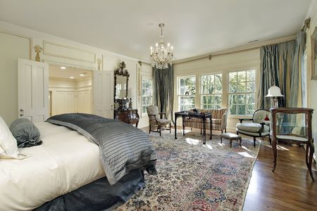 Master bedroom in luxury home with sitting room photo