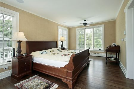 Master bedroom in suburban home with back yard view Stock Photo - 6739128