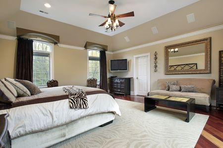 living room interior: Master bedroom in luxury home with tray ceiling Stock Photo