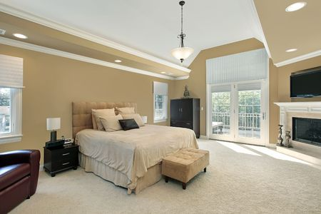 bedroom design: Master bedroom in luxury home with fireplace Stock Photo