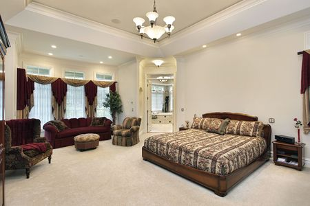 luxury bedroom: Master bedroom in luxury home with view into bathroom