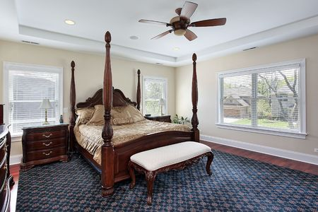 recessed: Master bedroom in suburban home with recessed ceiling