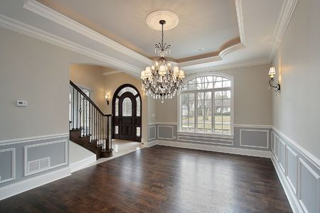 chandelier: Dining room in new construction home with foyer view