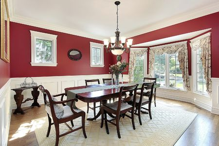 Dining room in suburban home with red walls Stock Photo - 6738347