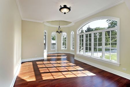 Dining room in new construction home with cherry wood flooring