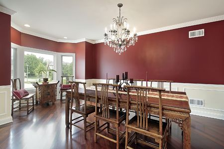 Dining room in luxury home with red walls Stock Photo - 6738449