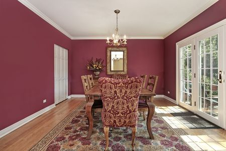 Dining room in suburban home with red walls Stock Photo - 6739031