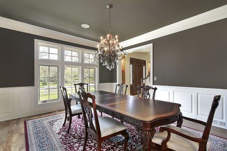 Dining room in new construction home with olive-colored walls photo