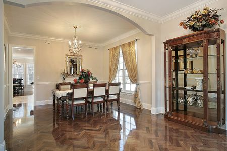 Dining room in luxury home with arched entry photo