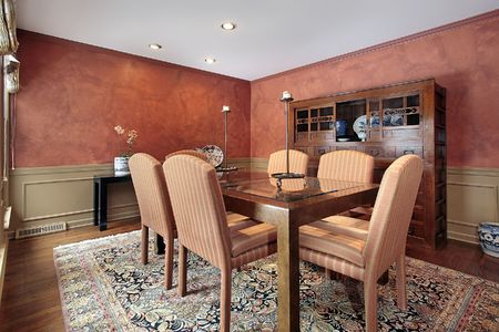Dining room in luxury home with orange walls Stock Photo - 6738332