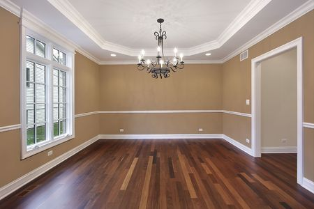 fixtures: Dining room in new construction home with tan walls Stock Photo
