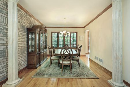 Dining room in suburban home with columns photo