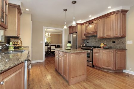 island: Kitchen in suburban home with center island