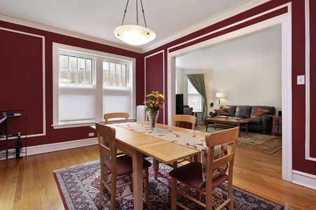 Dining room in condo with red walls Stock Photo - 6739294