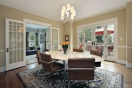 dining room: Dining room in suburban home with deck view Stock Photo