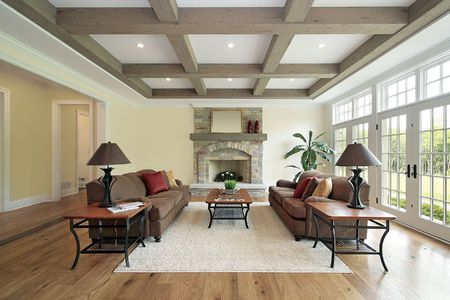 Family room in new construction home with wood ceiling beams Stock Photo