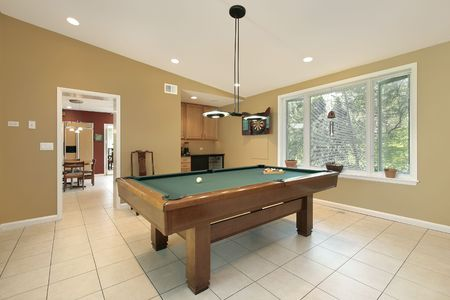 lighting fixtures: Play room in luxury home with pool table