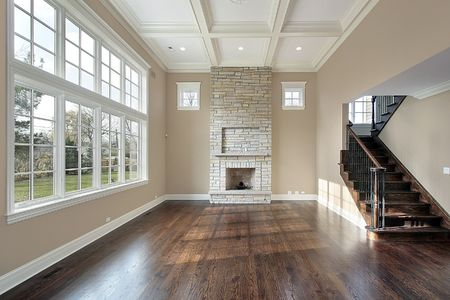 Family room in new construction home with two story fireplace photo