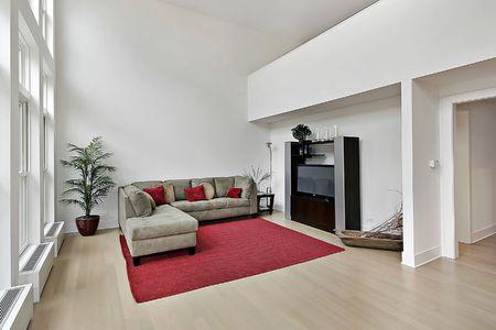Family room in luxury condominium with two story windows Stock Photo - 6738411