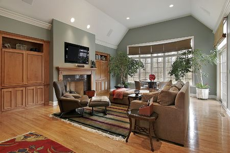 Family room in luxury home with marble fireplace