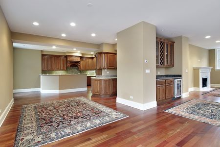 lighting fixtures: Family room in new construction home with cherry wood floors