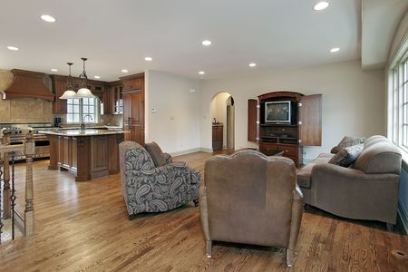 Family room in remodeled home with kitchen view photo
