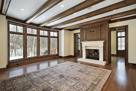 Family room in new construction home with wood ceiling beams Stok Fotoğraf
