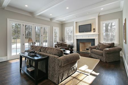 Family room in luxury home with back yard view