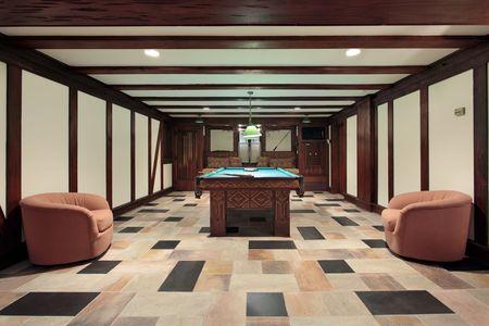 pool room: Basement pool room with wood beam ceilings Stock Photo