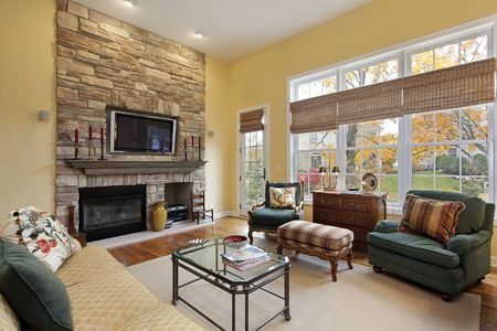 Family room in luxury home with stone fireplace Stock Photo - 6738893